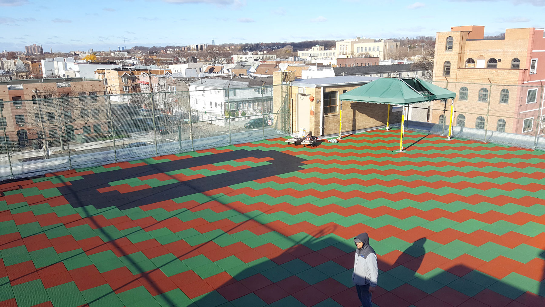 Rooftop rubber tile playground installation adventureturf - Playground surfaces for home ...