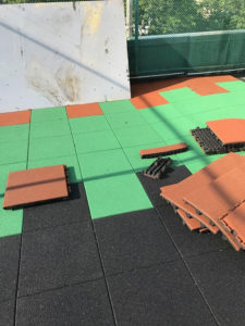 Installing rubber tiles for playgrounds