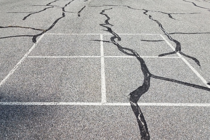 Pavement on playground surface with cracks