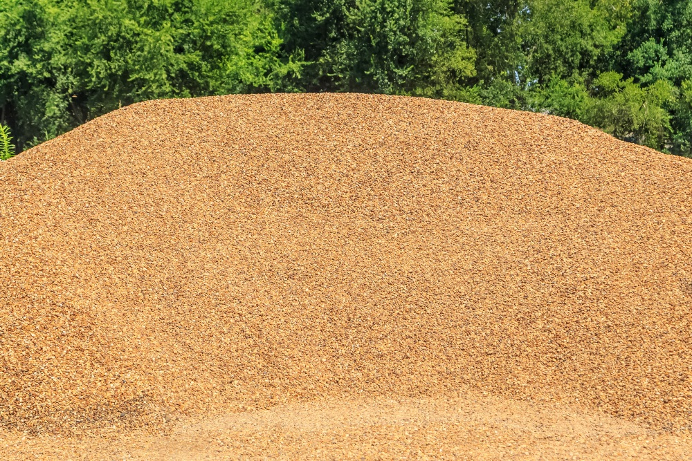 Pea gravel mound for playgrounds