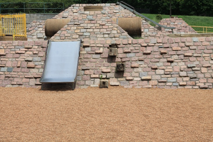 Pea gravel as playground flooring with slide