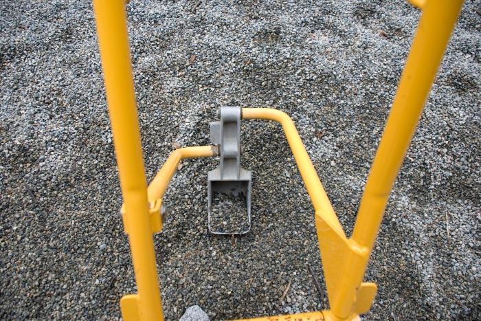 Pea gravel on playground floor with toy crane