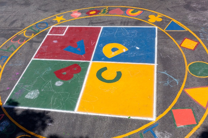 Four square painting on pavement surface